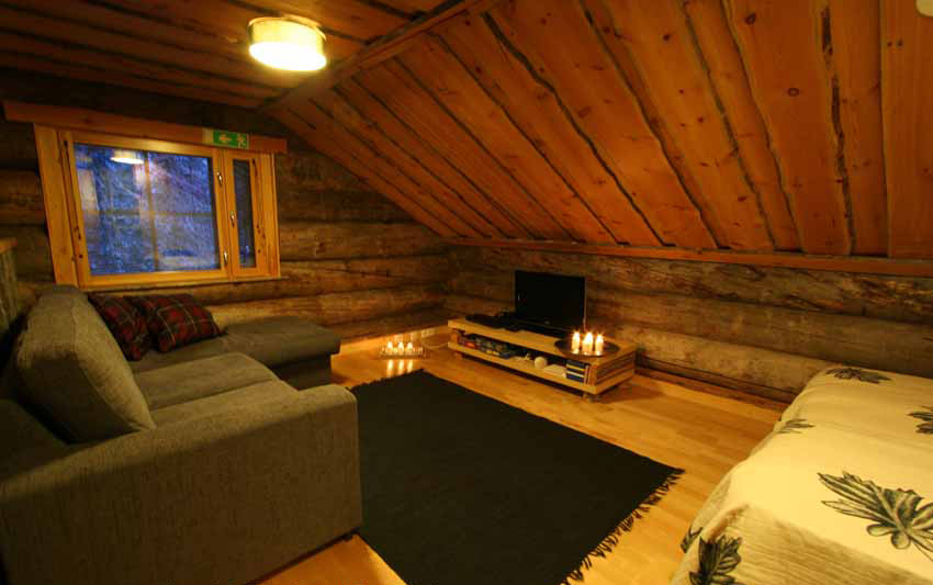 Gregory cabin upstairs landing with two single beds and separate sofa